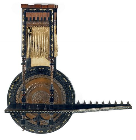 CARLO BUGATTI (1856-1940) DISPLAY SHELF, circa 1900, polished and stained walnut, inlaid in copper and pewter, with copper application and silk tassels, 33¾ in. (86 cm.) high; 32¼ in. (82 cm.) wide      SOLD $11,543 Christie's London, April 21, 2010