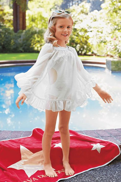 Your little girl will be dressed to the nines in this cute and fashion forward swimsuit cover up. The sequins and chiffon will update your pool to Hollywood glam!