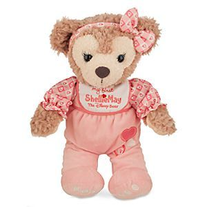 ShellieMay the Disney Bear Plush - ''My First ShellieMay'' - Medium - 12'' | Disney Store Soft, huggable ShellieMay cuddles-up to share sweet dreams and join in happy travels as baby grows! ''My First ShellieMay'' makes a bear-y special gift in her footed pajamas, embroidered bib, and bow.