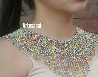 Set of necklace and earrings, handmade by Huichol artisans 3 Pieces Multicolor Measures Necklace Length: 43 Width: 6 cm more color strips Earrings: 2 cm