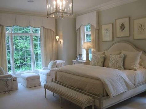Walls: Quiet Moments and trim: White Dove, both by Benjamin Moore. Serene and elegant master bedroom white and off white