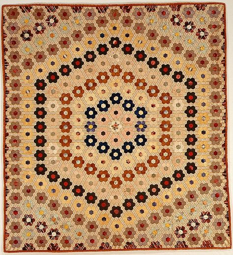 Quilt (or decorative throw). Hexagon or Mosaic pattern.  Maker: Possibly Caroline Brooks Gould Date: ca. 1870