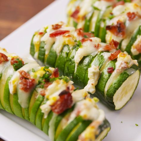 You've never seen zucchini like this before. That's right, we sliced it hasselback style and stuffed it with jalapenos, bacon, and cheese. Get the recipe at Delish.com. #delish #easy #recipe #jalapenopopper #zucchini #hasselback #keto #ketodinner #healthydinner #lowcarb #cheese