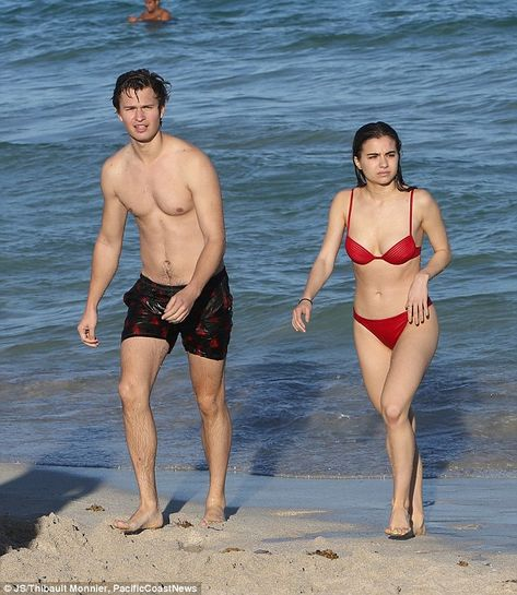 Looking good! Ansel Elgort, 22, splashed around in the ocean with his high school sweetheart Violetta Komyshan, believed to be 20, in Miami, Florida on Wednesday