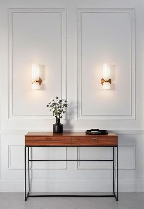 Edie explores the relationship between two similar forms. An exaggerated top column plays against the sconce's overall sense of quiet restraint. While Edie evokes a certain feeling of timelessness, it retains a fresh and modern presence. Wall Sconce Lighting, Wall Sconces, Wall Lamps, Task Lighting, Accent Lighting, Wall Trim, Wall Molding, Moldings, Entryway Decor