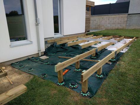 Installation des plots réglables de terrasse Terrasse bois mélèze - terrasse bois sur plots reglables