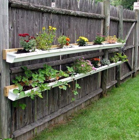 13 Vertical Diy Rain Gutter Garden Ideas For Small Spaces Gutter Garden Vertical Vegetable Garden Gardening For Beginners