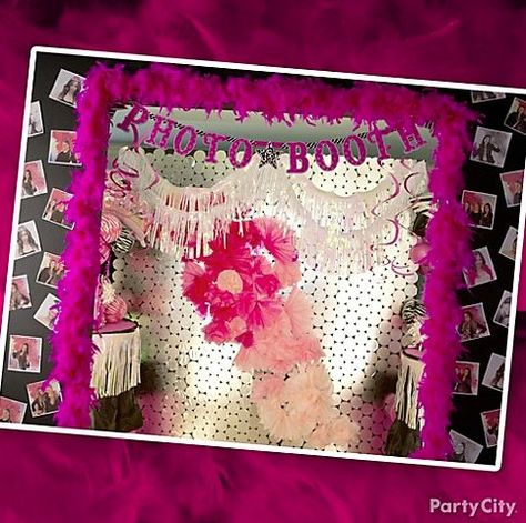 Pink & glam photo booth! Love the DIY mirror-circles backdrop, paper flowers and boas.