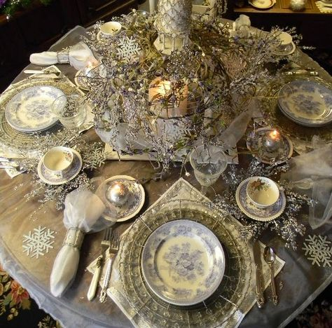 .snowflake wreaths under the teacup saucers.....beautiful