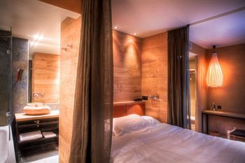 Cozy Hidden Hotel Bedroom Design build coves in a room, try wood flooring on wall