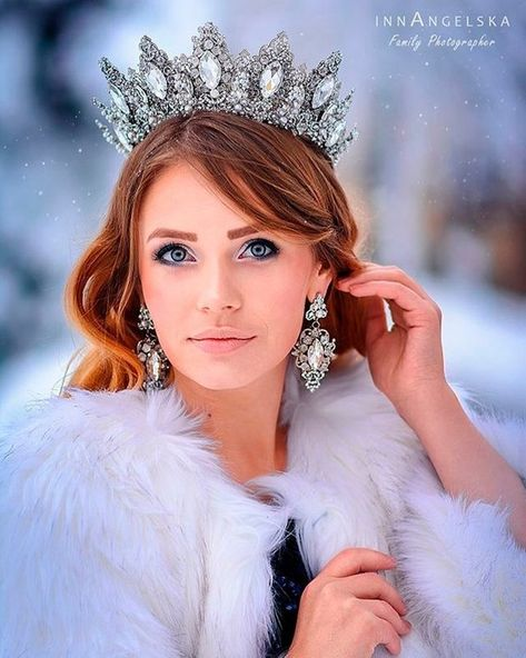 Gorgeous silver crown features beautiful clear-white crystals and radiant rhinestones in an chic design. Combs for added security and comfort. This crown is complemented with earrings in the same gorgeous style. Perfect for a wedding