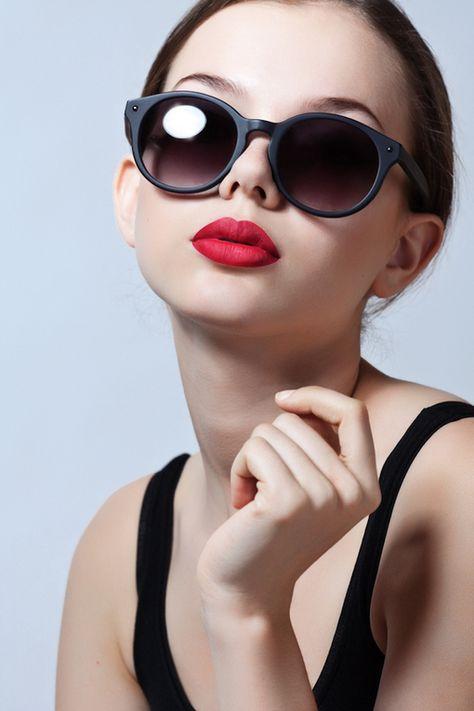 Big sunglasses and bright lips.