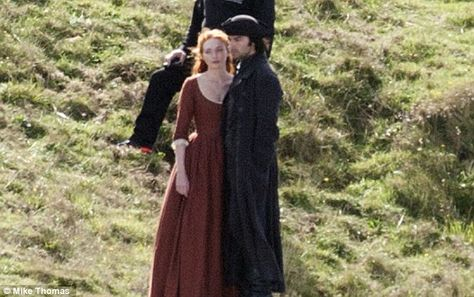 Hard at work:The actress, who plays Demelza Poldark in the popular show, joined co-star Aidan Turner as they got to work on set on top of a 300ft cliff