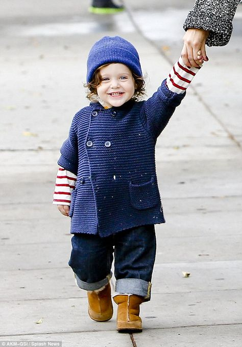Happy boy: Skyler wore an ear-to-ear smile as he toddled along with his equally stylish mother