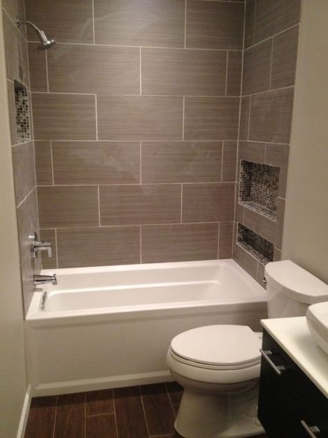WOW Over 10,000 Shares (Jan 15, 2016) From Old/Small to New/Big, Original Bathroom from the 50's with 30x36 shower in the master bedroom... The concept was to remove a closet from behind the bathroom and make it a full bathroom. , Daltile Fabrique Gris tiles, I designed custom niches with mosaic to keep the main wall as a design feature, wood-style tile on the floor to balance the modern, Kohler Archer tub for depth - Created a 10x5 space, Bathrooms Design