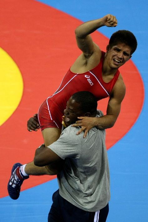 Inspirational Moments: Olympic celebrations - BEIJING - AUGUST 19: Henry Cejudo of the United States celebrates after defeating Shingo Matsumoto of Japan to win the gold medal in the men's 55kg freestyle wrestling event at the China Agriculture University Gymnasium on Day 11 of the Beijing 2008 Olympic Games on August 19, 2008 in Beijing, China. (Photo by Jed Jacobsohn/Getty Images)