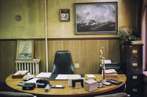 Irving Office 3: Set of Irving Rosenfeld's (played by Christian Bale) office.  Shot on location in Lynn, Massachusetts.  Furnished with distressed  but stylish couch and desk and geometric wallpaper as seen in Columbia Pictures' AMERICAN HUSTLE.  Production Design by Judy Becker Photo by:  Judy Becker
