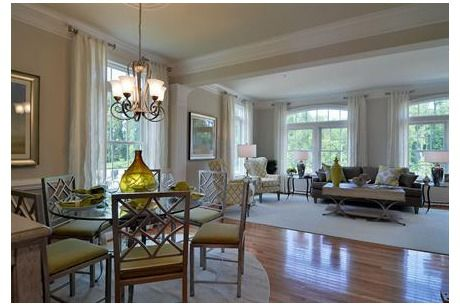 Gleaming wood floors and a wall of windows bring the outdoors in. The Astor Hall. New homes by NVHomes at Fairwood Townhomes. Bowie, MD.