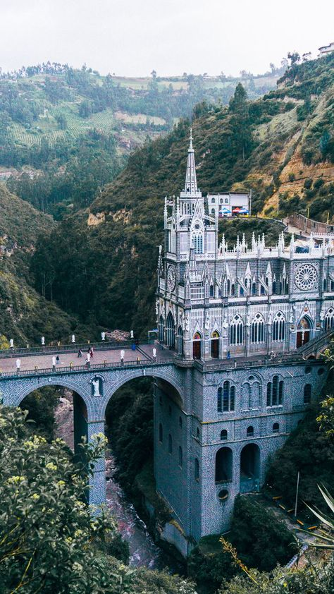 Taking an air tram to Santuario De Las Lajas church - one of the top things to do on a trip to Colombia!
