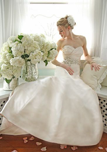 This gown's sweetheart neckline with its large skirt is a flattering style for a classic look.
