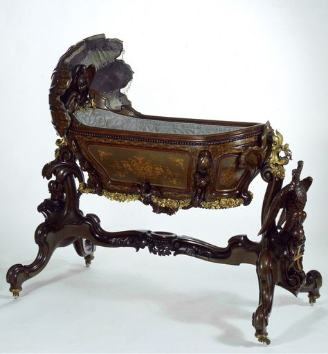 Crown Prince Rudolph cradle. Made by Franz Matthias Podany from mahogany, maple and bronze mounts, 1858.