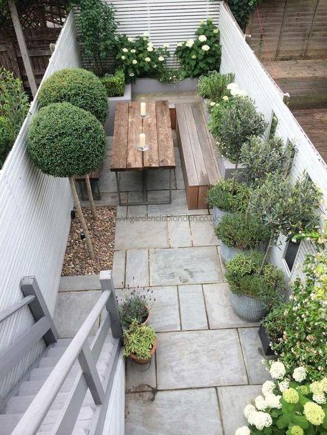 Slim rear contemporary garden design in London