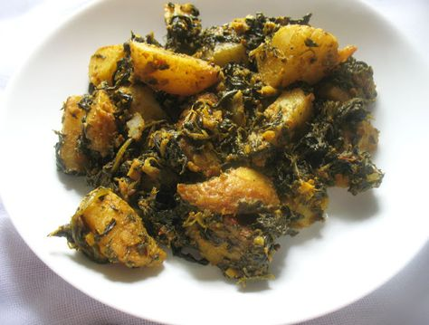 Saag Aloo (Spinach and Potato Curry) -- or just boil potatoes separately, add to wok of spinach, spices & maybe other veg.