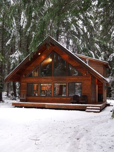 Chalet-style cabin nestled in a forested setting. Inviting great room w/vaulted wood ceilings, skylights, bright 2-story window wall, propane gas stove w/river rock surround & dining area off the cook's kitchen. ...