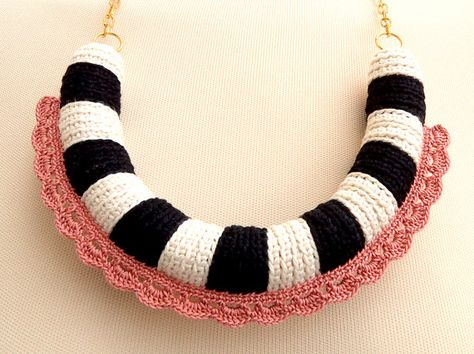 U shaped necklace with black and white segments and by bibatron