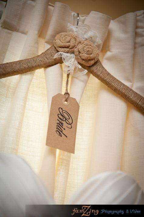 Decorate bride's hanger with burlap roses.