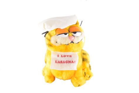 Cute vintage Chef Garfield soft toy plushie with a bib or apron that reads I Love Lasagna. This is a great collectible of Americas favorite fat