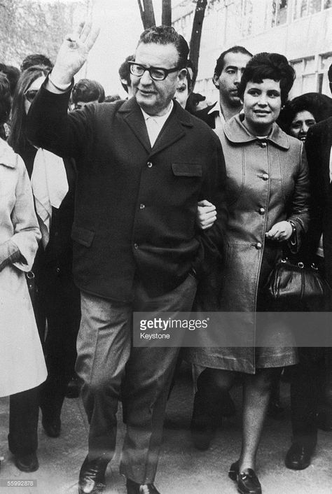 Salvador Allende , the new president of Chile strolls through the...