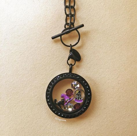 Origami Owl Black Crystal Living Locket face w/Swarovski Crystals... You can visit my website at http://yourcharminglocket.origamiowl.com/ Have further questions, email me at YourCharmingLocket@gmail.com or message me on Facebook https://www.facebook.com/YourCharmingLocket. --- Want more than just one locket, consider joining my team for an extra income.