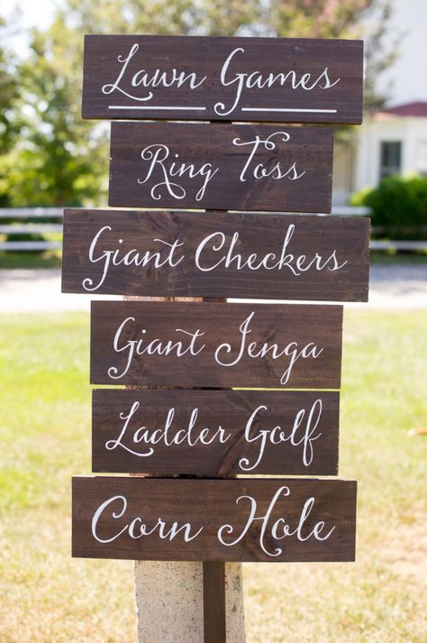 Lawn games wedding sign: http://www.stylemepretty.com/connecticut-weddings/north-stonington/2015/12/31/rustic-floral-filled-connecticut-winery-wedding/