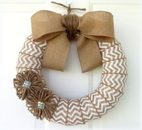 """Chevron Burlap Wreath.one pinner said, """"Use velcro pieces to interchange seasonally (flowers, felt pumpkins, snowflakes, hearts, turkey, reindeer, Easter eggs etc.)"""" I saw where you could also hot glue a clothespin to the back of your interchangeable wreath décor for easy attachment/detachment as well."""