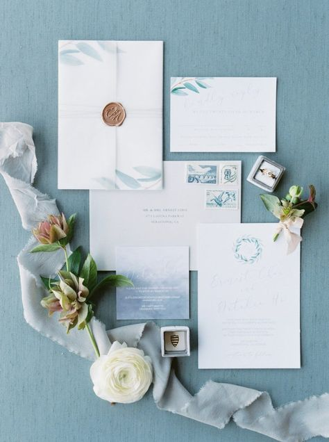 Lovely gold seal on these blue wedding invitations.