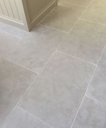 Paris Grey Limestone Floor Tiles A Consistent Light To Medium Grey Stone With A Hint Of Blue Tone And Cloudy App Kitchen Flooring Kitchen Floor Tile Flooring