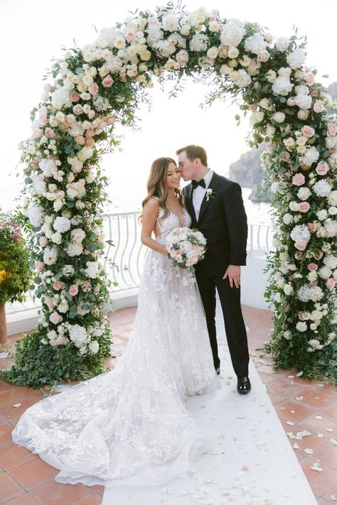 Travel Blogger Christine of Tour de Lust looks timeless in our #GALA210 tulle embroidered ballgown with embroidered lace trimming and immense floral patterns for her Positano destination wedding.