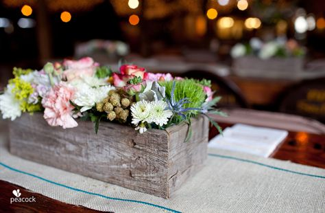 centerpieces...handmade old barnwood flower boxes with an assortment of flowers on burlap