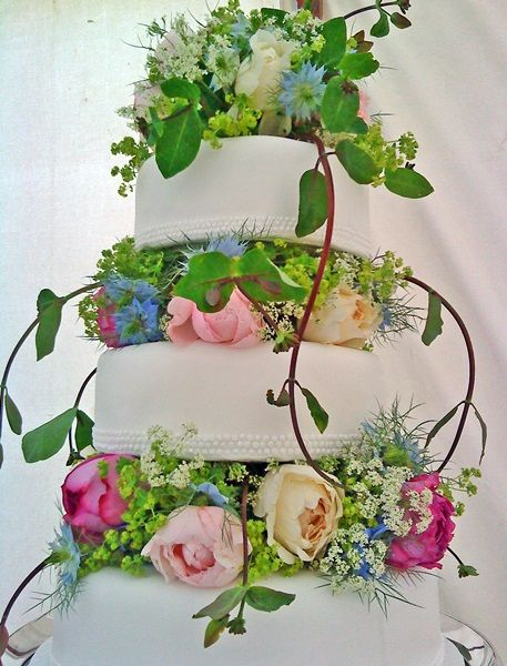 English Country Flower Garden Cake, decorated by Catkin Flowers.... looks just like my friend Jill's wedding cake, but her's was about 5/6 tiers high & was very very expensive..........was so delicious, every teir was a different flavor: Peach Snapps, Frangelica, etc...