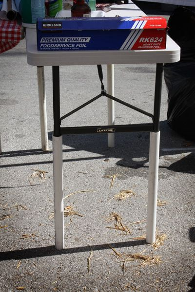 MRL thinks this is brilliant if it really works!  Make a folding table taller (to use as a buffet or work table) with pvc pipe!