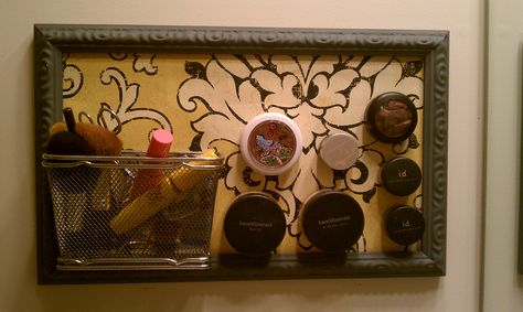 makeup magnet board. made from thrift store frame (spray painted gray) and wall-paper sample from an online store.