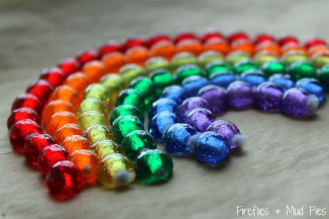 Make a Rainbow Suncatcher You will need: 6 white chenille stems faceted plastic beads (red, orange, yellow, green, blue, purple) cookie sheet parchment or waxed paper scissors and wire cutters fishing line