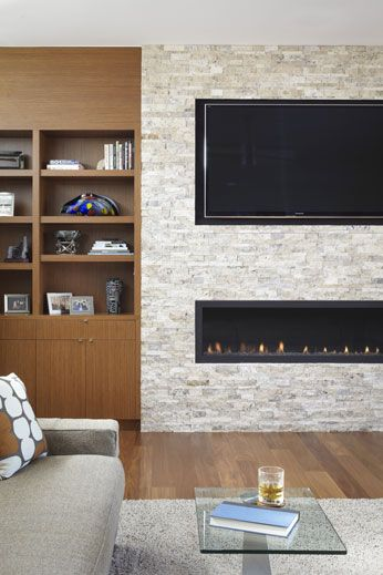 discreet tv fireplace and builtin shelves and cabinets