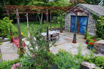 "I know this is about the pergola but my interest is the stone ""barn"" with blue doors. That is the awesome focal!  From HOUZZ"