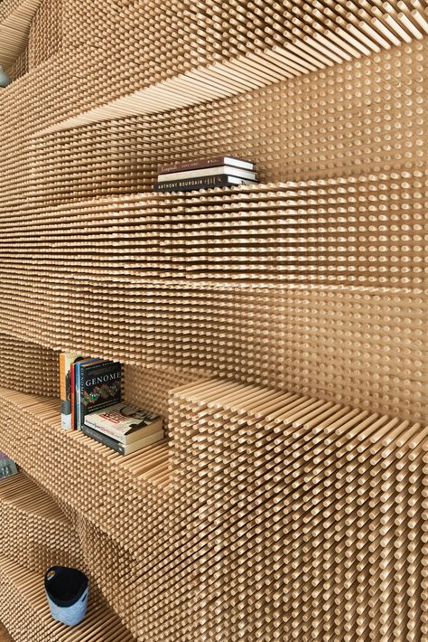 Massachusetts fun modern graphic textural bookcase wall shelving made from over 40,000 dowels