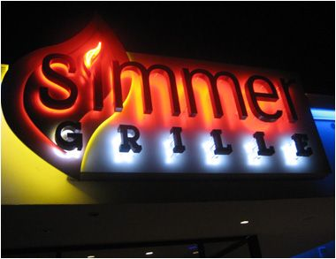 Try to turn the heat down when you see a sign like this. Colorful halo lighting radiating from multiple layers and an exposed neon flame, warmly welcome visitors to this West Hartford, CT restaurant.