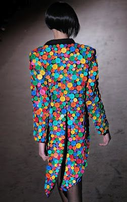 eye-popping use of buttons. Jacket by Patrick Kelly.