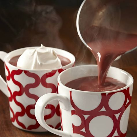 Get cozy with a mug of this rich red velvet-tinted hot chocolate. Serve with a decadent dollop of Vanilla Whipped Cream, if desired.