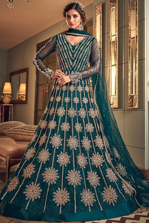 Cast a spell with this Peacock Green Net Anarkali Suit Which will surely tell them that the diamonds aren't the only beautiful thing which they have seen.This V neck and Full Sleeves Party Wear Attire highlighted with stone, sequins and dori work. Along with Santoon/Lycra Churidar in Peacock Green Color with Peacock Green Net Dupatta. Dupatta highlighted with Stone Work. This Anarkali Suit can be customised up to 58 Inches around the Bust. Slight color variation may occur due to photographic rea